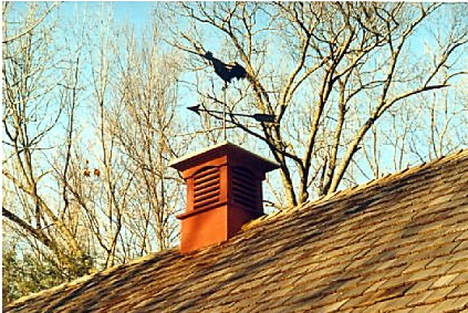 louvered cupola with copper rooster weathervane