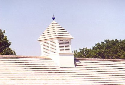 louvered cupola with finial