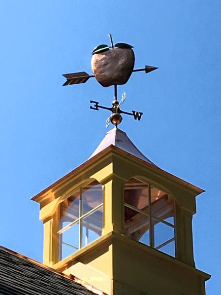 windowed cupola with weathervane