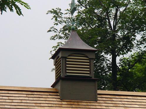 louvered cupola with copper sailboat weathervane