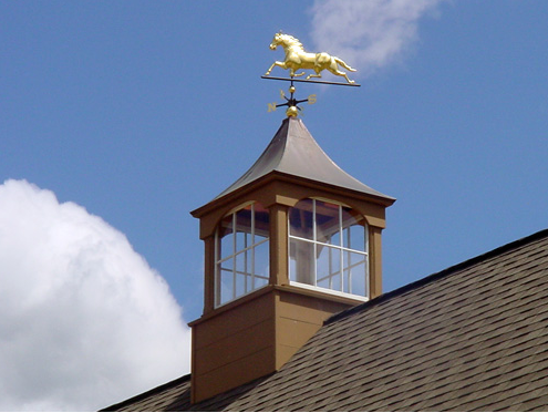 copper roof windowed cupola with copper horse weathervane