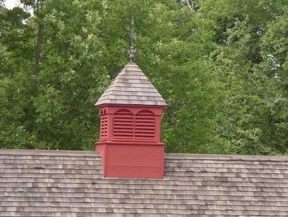 louvered cupola with copper saw weathervane