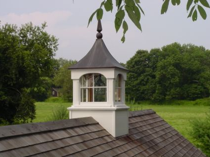 copper windowed cupola with copper finial