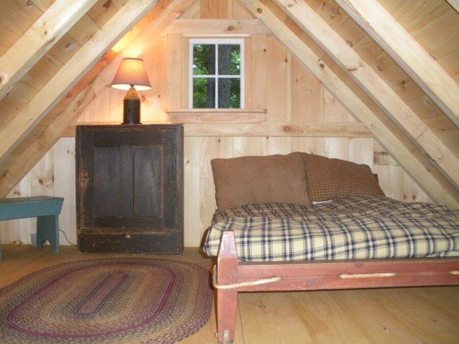 timber frame loft with bed and end table