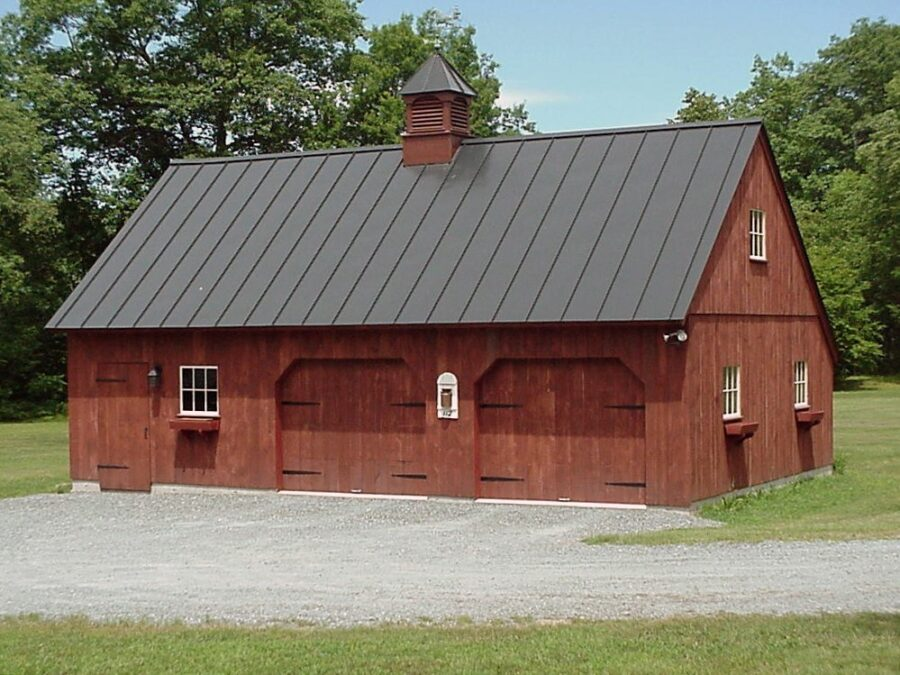 Brown carriage house with metal roof