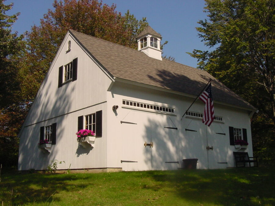 White Saltbox Garage with flower boxes