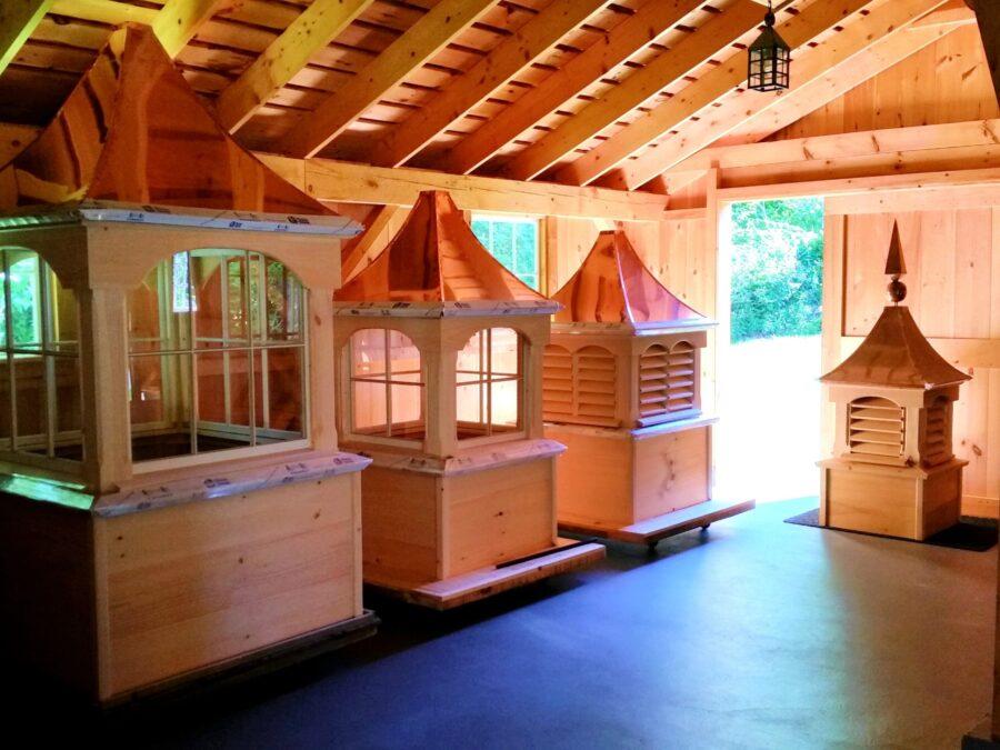 Cupolas sitting inside Post and beam barn