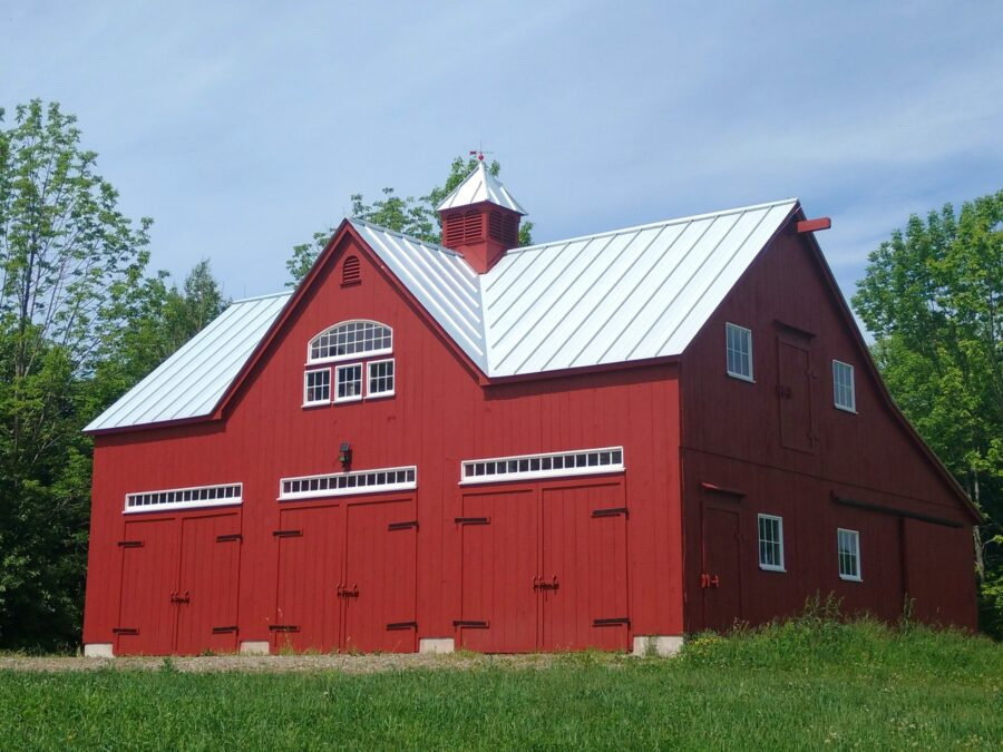 Large Red Barn with a Peak Dormer, Bowtop and Transom windows and Metal roof