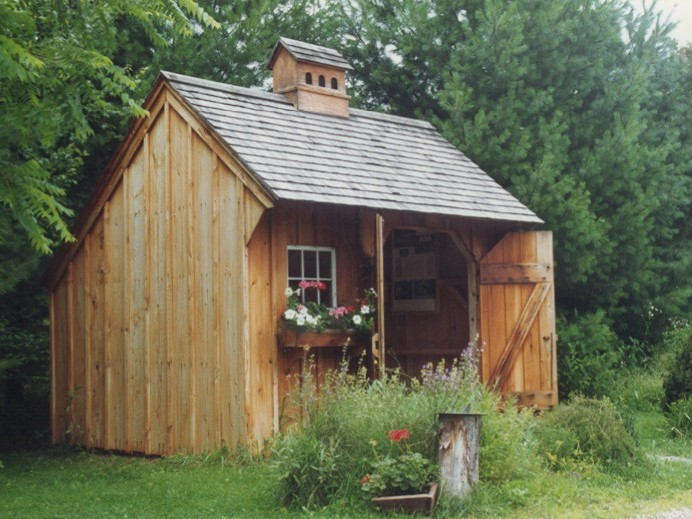 A natural New England Style Saltbox Garden Shed with Flowers under the window