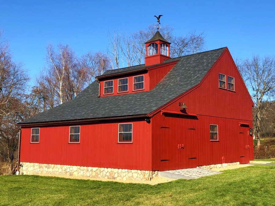 Red Post and Beam Barn with a Shed Dormer and Cupola