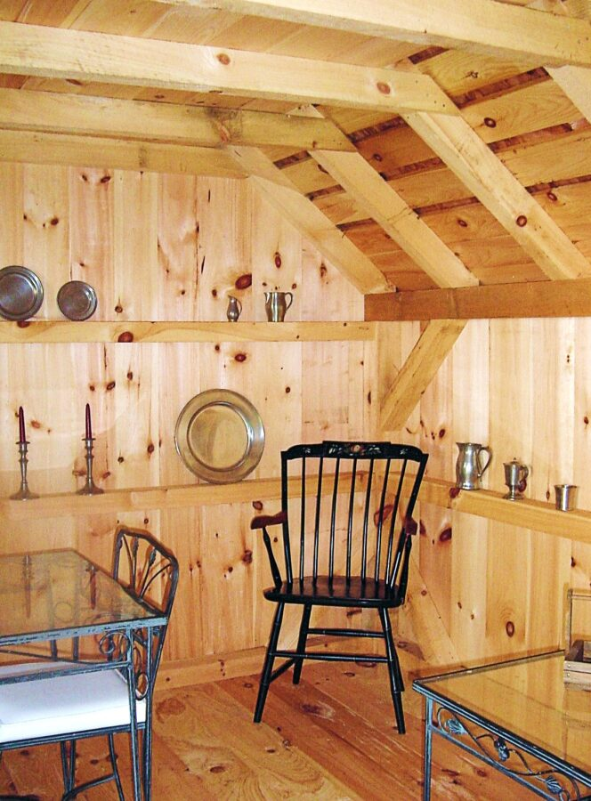 Inside view of Saltbox Post and Beam Garden Shed with Chairs and tables