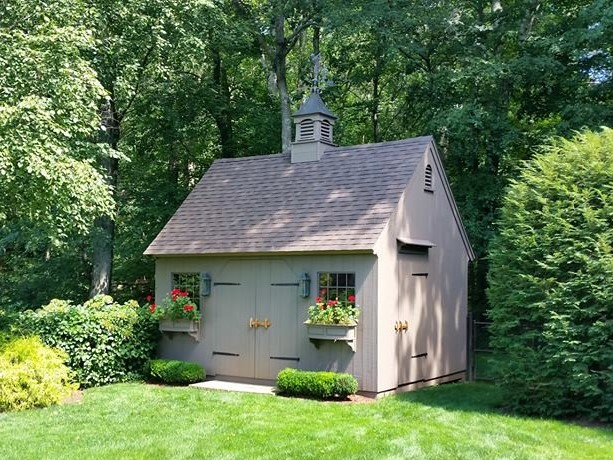 A Grey, New England Style Saltbox Garden Shed in Nature