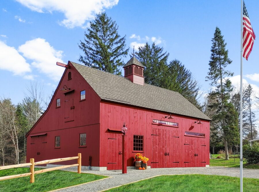 Red Barn with a blue sky and an American Flag